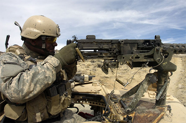 special forces soldier fires m2 machine gun