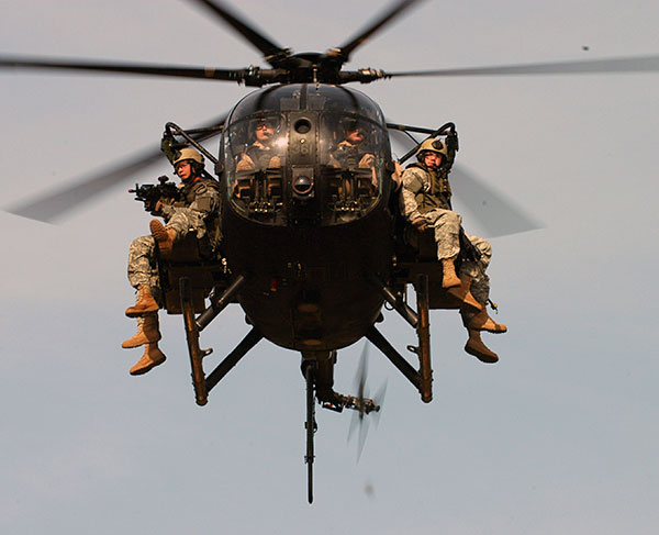 MH-6M pictured in-flight, carrying Rangers strapped to benches along ... Army Helicopters In Action