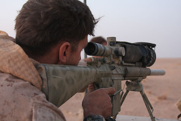 A US Marine Scans Across The Desert Into Syria From Iraq Using Magnum Universal Night Scope Mounted On MK11 Mod O Rifle